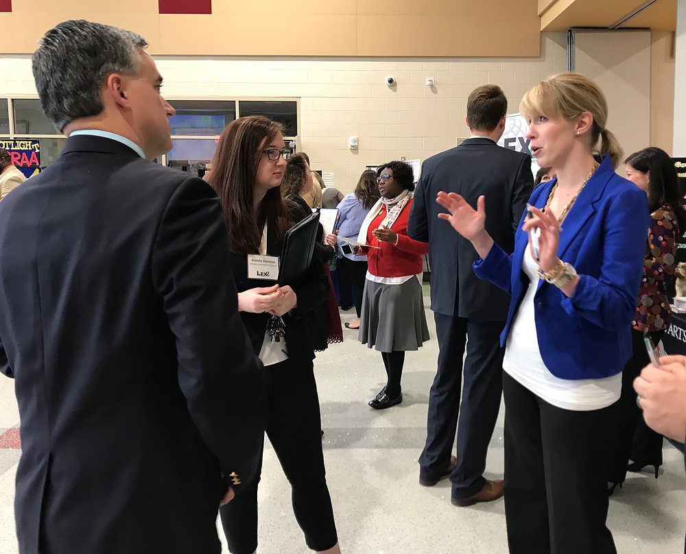 Fulmer Middle Principal Megan Carrero, right, talks about her school during last year's Teacher Recruitment Fair.
