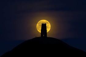 Wolf Moon Behind Glastonbury Tor