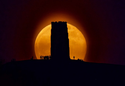 Super Flower Moon Behind Glastonbury Tor