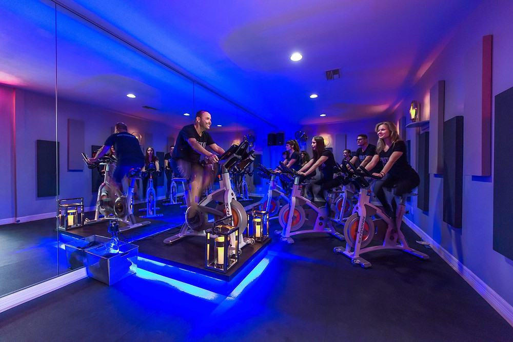 Indoor spin class cyclists here in Houston
