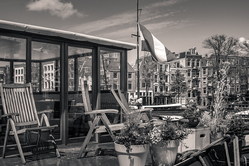 Relaxing on a Houseboat in Amsterdam-Black and White photo, stock image by Kaan Sensoy