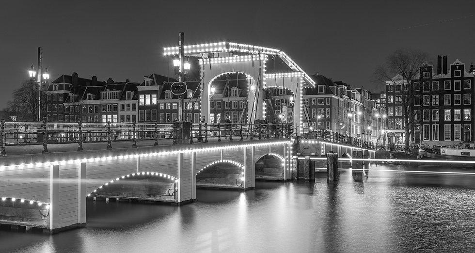 Skinny Bridge (Magere Brug) at night, Amsterdam - B&W photo by Kaan Sensoy