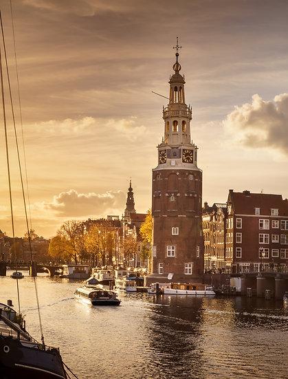 Sunset in Oudeschans Amsterdam and Montelbaanstoren - photo by Kaan Sensoy