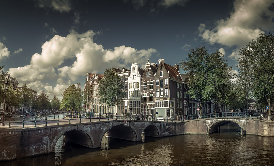 A Sunny Day Canal View in Amsterdam - stock image-photo by Kaan Sensoy