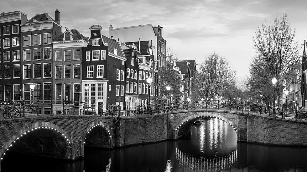 Reguliersgracht in an Autumn Evening in Amsterdam -  Black and White photo by Kaan Sensoy