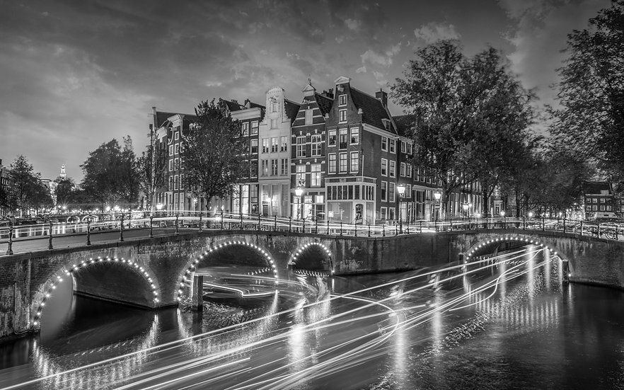 An Amsterdam Canal View with Light Trails - B&W photo by Kaan Sensoy