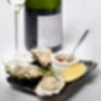 Oysters and white local dutch wine.  L'invité Bloemgracht, Amsterdam. Restaurant and Food Photography by Magic Eye Studio. Food fotografie, Food photographer Amsterdam.