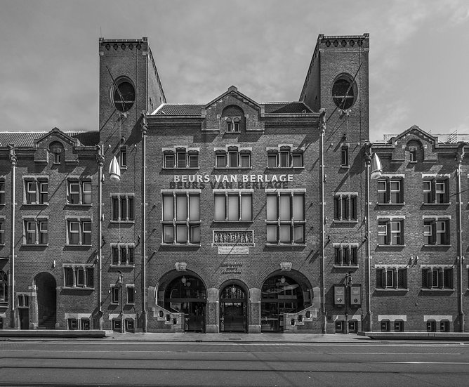Beurs van Berlage, former stock exchange building in Amsterdam-Black and white stock image- photo by Kaan Sensoy