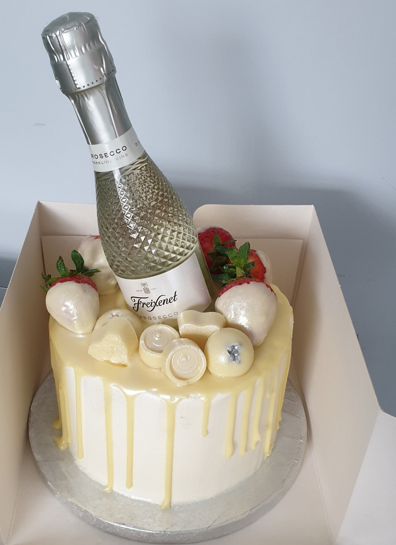 Champagne and chocolates drip cake
