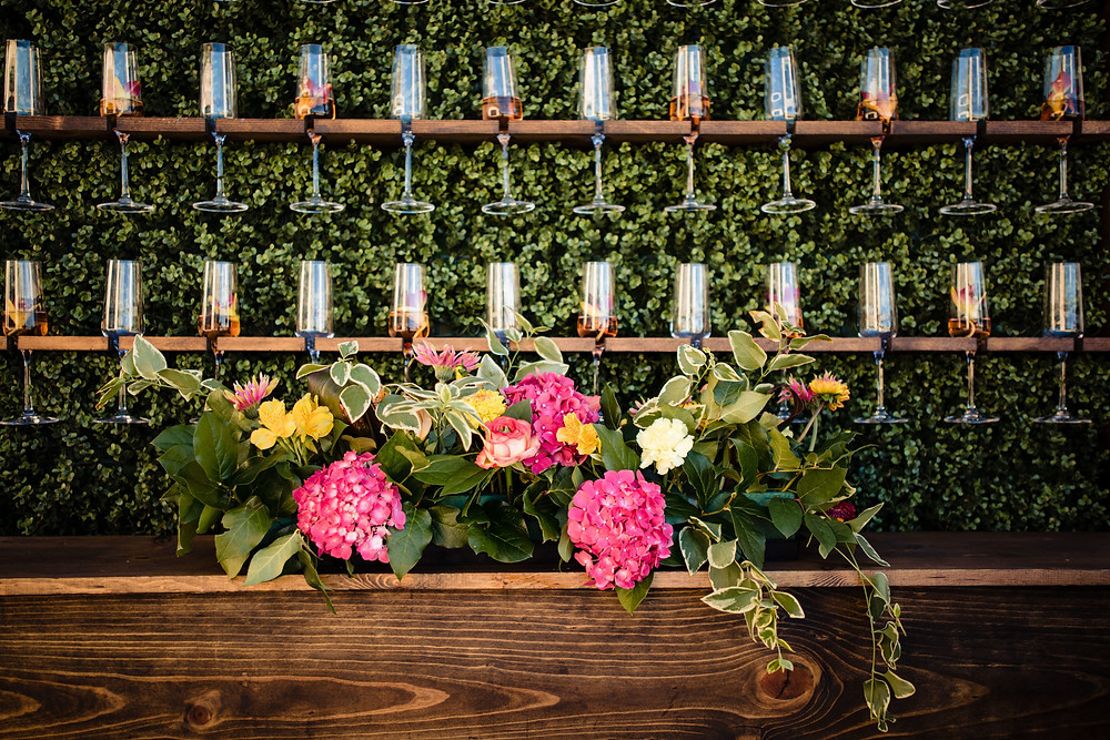Champagne wall with floral arrangement