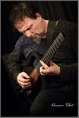 Alain Pierre  ( Sitting in some café )