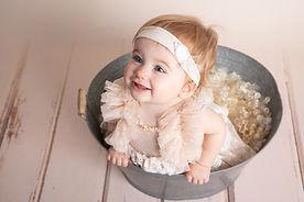 Séance photo bébé tient assis