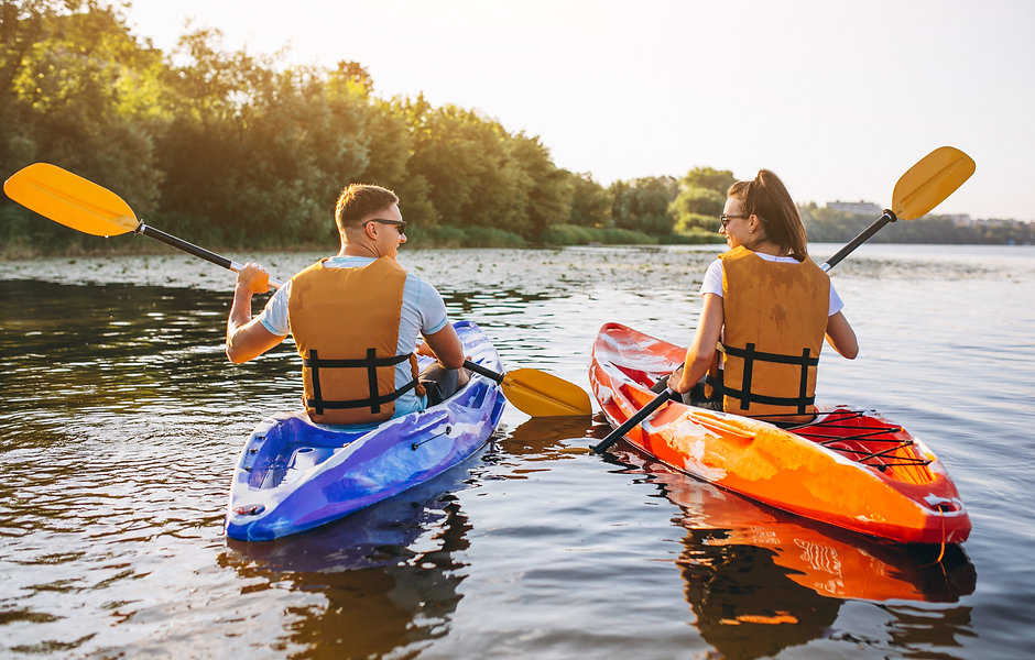 Couple together kayaking on the river.jp