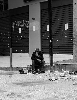 person-sitting-near-building-2180863.jpg