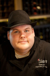 Headshot of Dave Heide in black hat and chef jacket.
