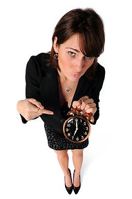 businesswoman-pointing-to-clock-6748081.