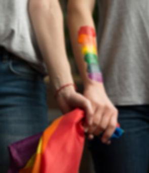 close-up-lesbian-couple-holding-lbgt-fla
