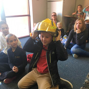 student-wearing-fireman-helmet.jpg