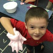 student-hands-on-slime.jpg