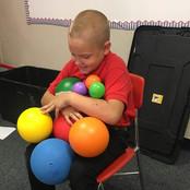 devotional-student-holding-balls.jpg