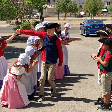 students-in-colonial-dress-dancing-2.jpg