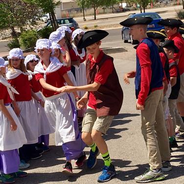 students-in-colonial-dress-dancing.jpg