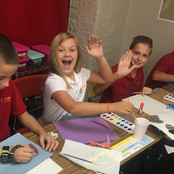 students-waiving-and-painting-art.jpg