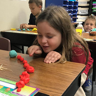 student-playing-with-playdough-concentra