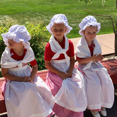 young-girl-students-in-colonial-dress.jp