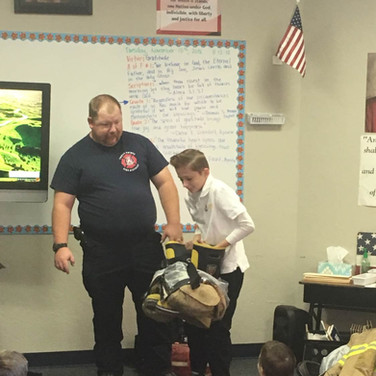 student-wearing-fireman-boots.jpg