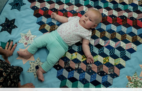 PL16 Baby on Quilt