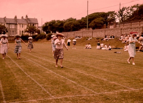 """Miss Bristol, far left, Miss Farmer, Mrs. Lawrence, centre Mrs. Webb, far right; and others """"staff games 61_62"""