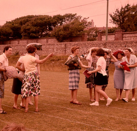 """Miss Bristol, far left, Miss Farmer, Mrs. Lawrence, centre Mrs. Webb, far right; and others """"staff games"""""""