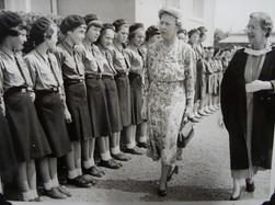 L-R: Vivienne Ottaway; Rowan (Cawkell) Fookes; Phyllida Bennett; Pamela (Read-Jahn) Bailey, Shirley Foulsham; Shirley Read-Jahn; Celia Kimmins; Nicola Bruton; Anne Jarvis; Gloria Smart; Gillian (last name?). Princess Mary and the Headmistress, Doris Conrady.  Alternative identification by Elizabeth (Libby) Harris (Howell-Davies) is