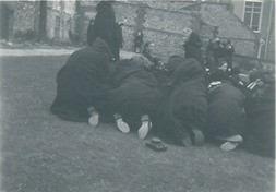 Keeping warm huddling with cloaks - kindly supplied by Jane Wharton (Alsop)