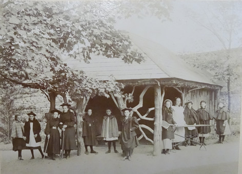 Pupils standing under Charlotte Elliott's Bower (Summer House), which had been removed from Westfield Lodge, Brighton. c1880