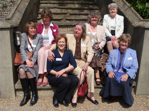 Jean Ellis in Blue, On the edge RHS is Jean Pearson; behind her ( in pink) Jenny Reekie. Top right is 'Titch' (Alison Vaughan). Jennifer Riley Wray is in the beige trouser suit, slightly behind and to Jean's left, with her arm on JE's shoulder. Liz Baker Caudle is behind/L of Jenny. Right Front is Lizzie Julyan (Allwright)