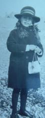 Diana Talbot on Brighton beach, early 1930s school uniform