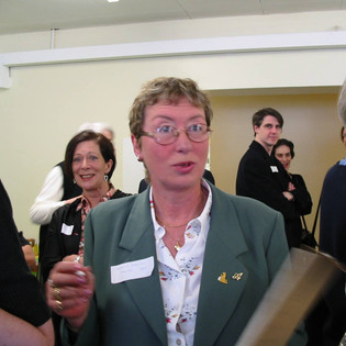 2002 - Jean Ellis, smiling, over Angelica Meletiou's shoulder. Liz Johnson-Barrett (blonde) and Penny Buckland (silver grey) with their backs