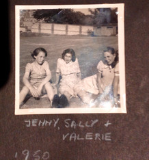 """Jenny Booth, Sally Landau and Valerie Herbert, 1950. The """"gardens"""" in front of the wall. Miss Smith was the weekend mentor gardener. Photo supplied by Susan Metzner"""