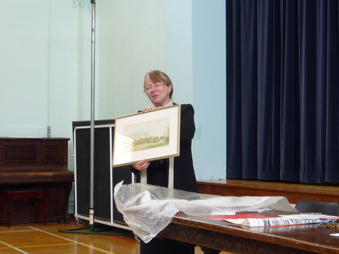 Penny Gardiner and her framed print of the school.