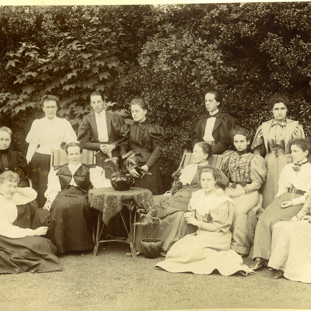 1896 - Standing 3rd from left is Miss Potter, 5th from left is Miss Burrell.