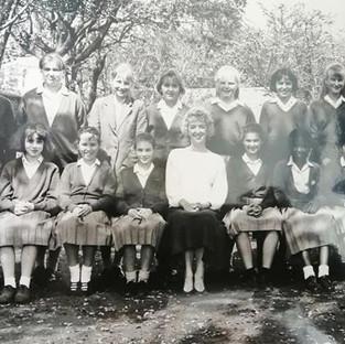 c1990, Form 1 with Miss Cutress. Left to right front row: Clare Newman, Naomi McMath (Titlow), Sarah Peacock (Swinford), Jennifer Fletcher (Mathews), Miss Cutress, Hannah Nee (Crockett), Doyin Eleso, Rima Warrell (Shuman), Jackie Proe  Back: Nneka Ikedife, Lisa Wright, Leonie Aspinall?, Vicky Lewis, Lucy Barnes, Emma Drew, Charlotte Ede, Samantha Cook