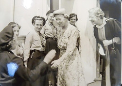 Dorothy Cook ( Stranack) was company leader of the 2nd Brighton Guide company and can be seen in this image between the Princess Royal and the Headmistress, Doris Conrady. Dorothy tells us that she has been involved in Guiding ever since, in many positions and enjoyed it all, especially camping! Judith Barrington tells us that the girl facing the camera and smiling is Sarah Boyd (Milne).