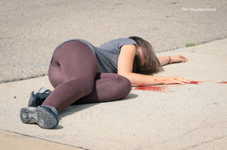 47 Young girl on ground in front of church
