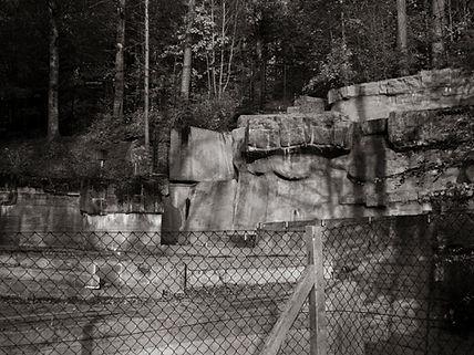 The empty bear pit at Adliswil Wildnispark in Zurich, Switzerland by Robin Cox.