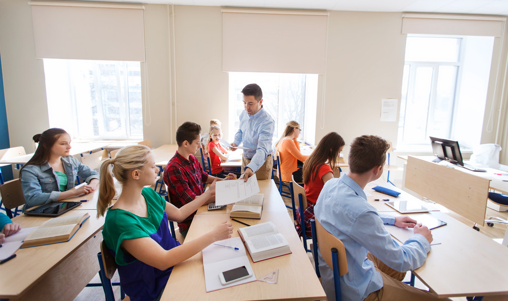 male-teacher-in-high-school-classroom.jp