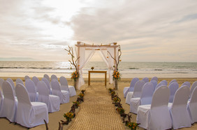 wedding on the beach scene with sunset.j