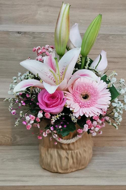 FLOWERS IN HANDBAG POT