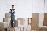 young-man-working-warehouse-with-boxes_1